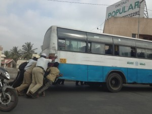 Police having to push bus on KH Road flyover, Bangalore